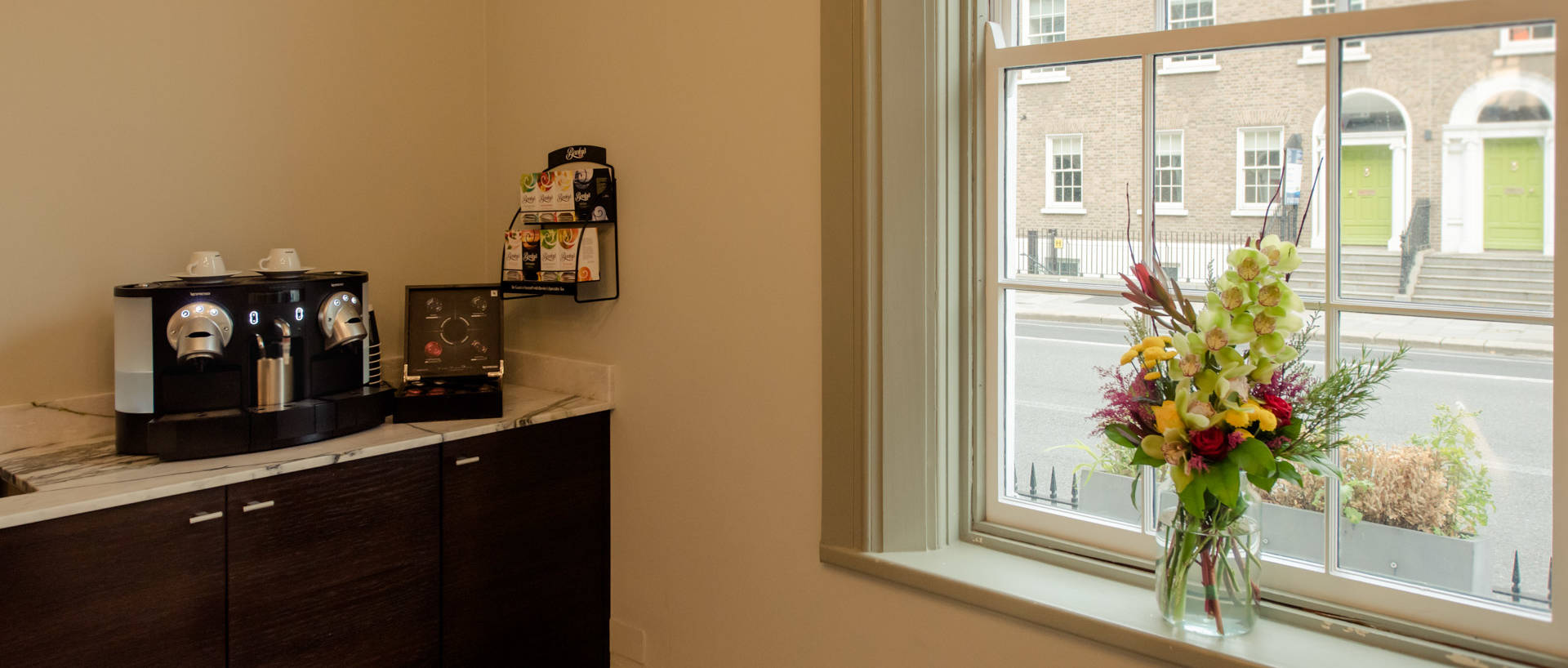 PREMIER SUITES PLUS Leeson Street window and coffee